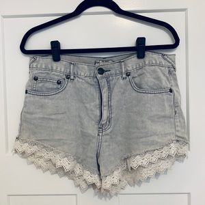 Free People light denim shorts with lace edging!